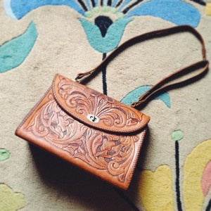 We got this vintage hand-tooled leather bag for $50 yesterday!…