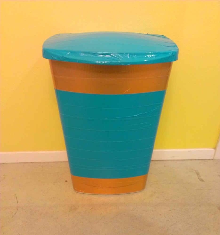 trash6 935x1000 How to Make Your Trash Can Look Less Ugly With Duct Tape featured fashion  trash can project Justin Bieber Duct Tape how to make your trash can look nicer how to make a trash can featured Duct Tape project Duct Tape prints Duct Tape mustache Duct Tape creation Duct Tape crafts Duct Tape art DIY trash can DIY projects creative trash can project