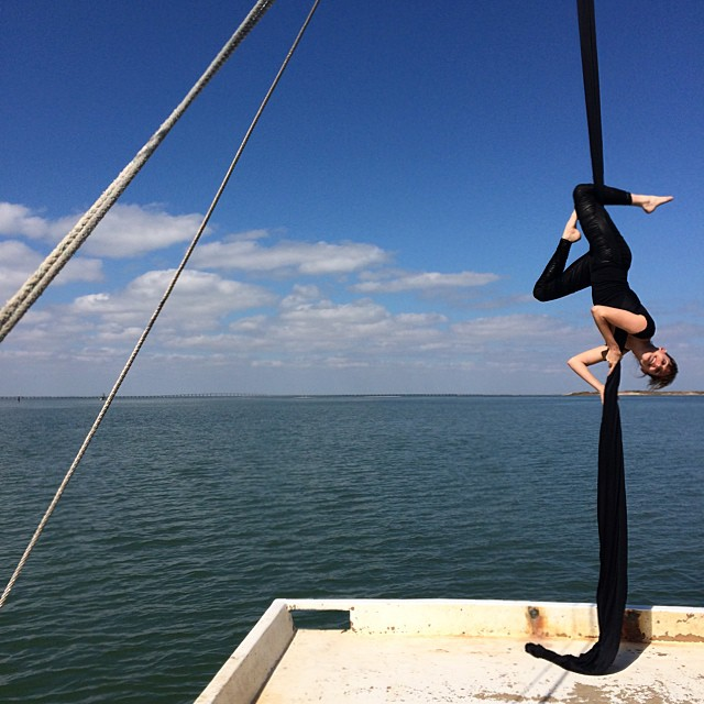 Yes, that is a beautiful woman doing aerial silks on a moving shrimp boat. #TexasGulf #yoga #lifeisinteresting