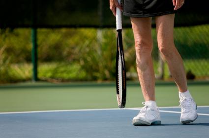 senior woman at the tennis court