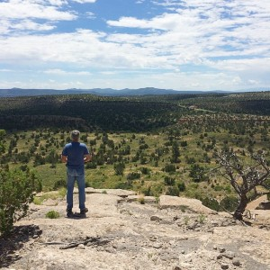 Dad staring out at Bandelier National Monument  I tryhellip