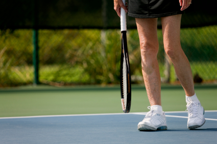 senior woman at the tennis court