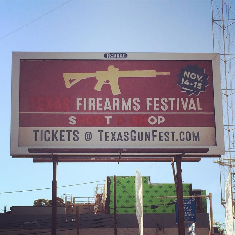Someone really hates that billboard. // #eastaustin #guncontrol